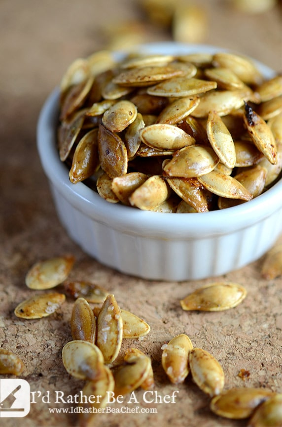butter roasted pumpkin seeds in a dish