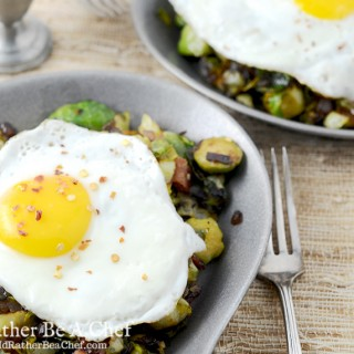 Piercing the slow cooked egg on top of the brussels sprouts and bacon hash will make your mouth water. Gluten Free, Paleo, Low Carb