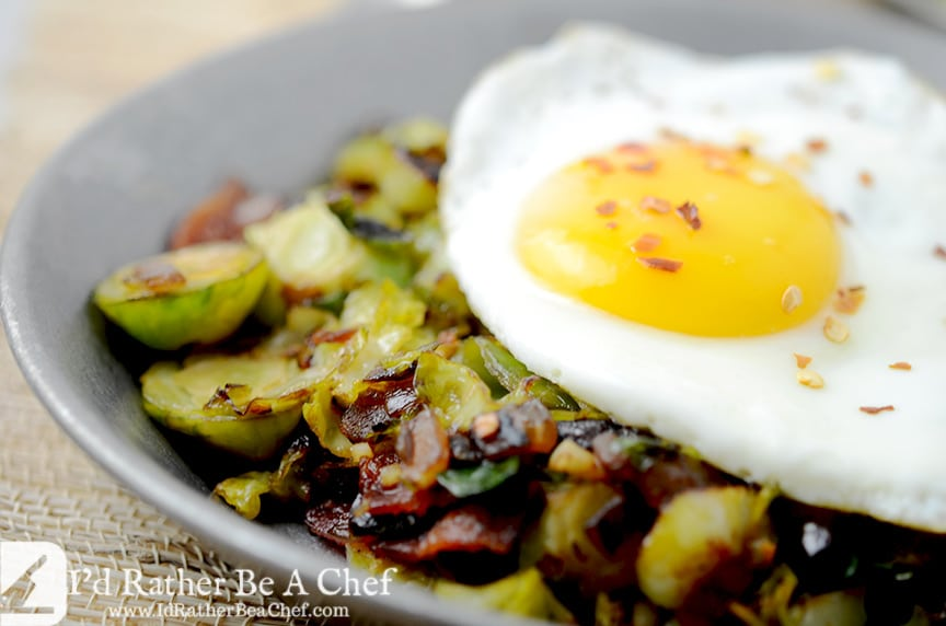 Piercing the slow cooked egg on top of the brussels sprouts and bacon hash will make your mouth water.