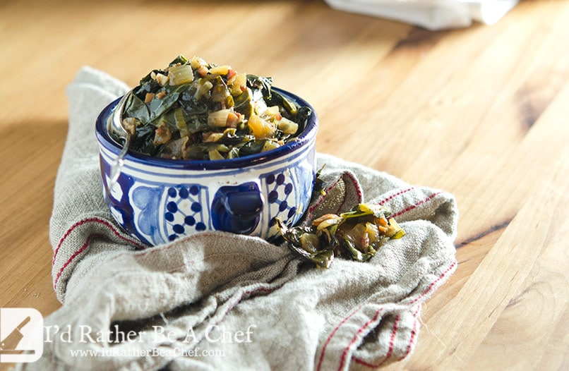 Slow cooked souther collard greens are made with love... and bacon! Fresh garlic and chicken stock take this recipe back home.