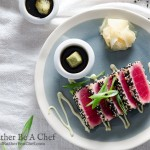 A perfect seared ahi tuna recipe with sesame seeds looks like a stained glass window with bold pink hues. Perfectly simple and delicious with a wasabi mayo and mirin dipping sauce.