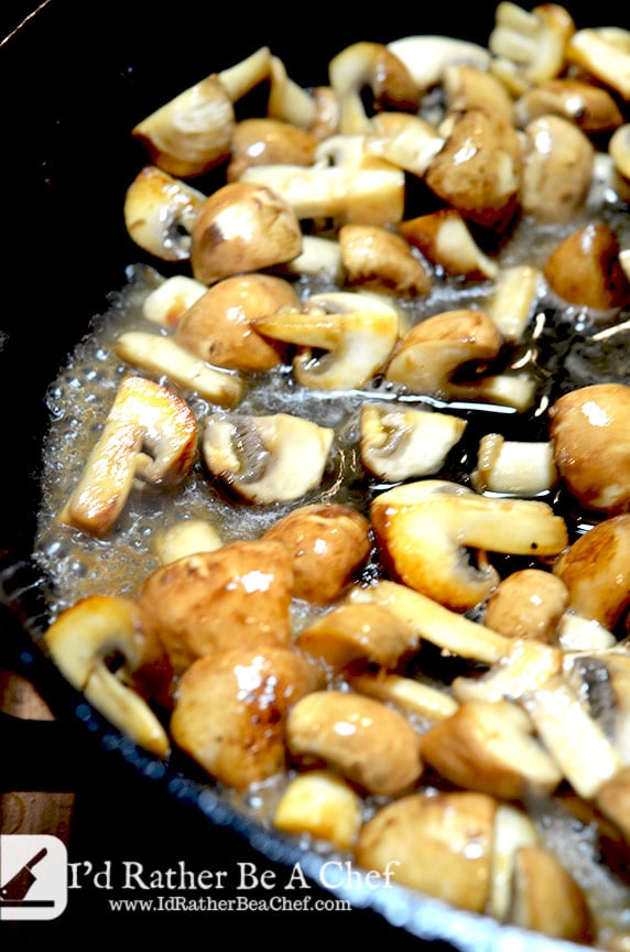 White wine, quartered mushrooms and garlic add complexity to this slow cooker coq au vin recipe.