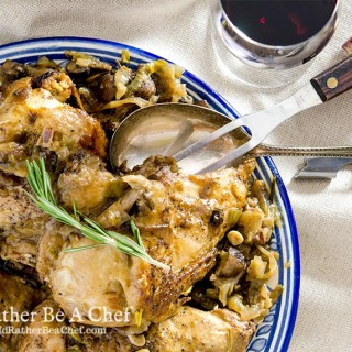 A country style slow cooker coq au vin recipe made with crisp French chardonnay, onions, mushrooms and garlic. So good you'll make this again and again.
