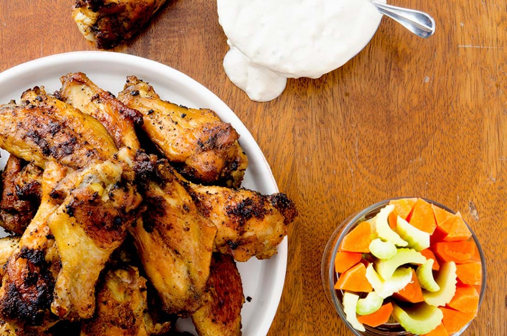 Delightfully crunchy and crispy baked chicken wings recipe with a dry rub and blue cheese sauce.