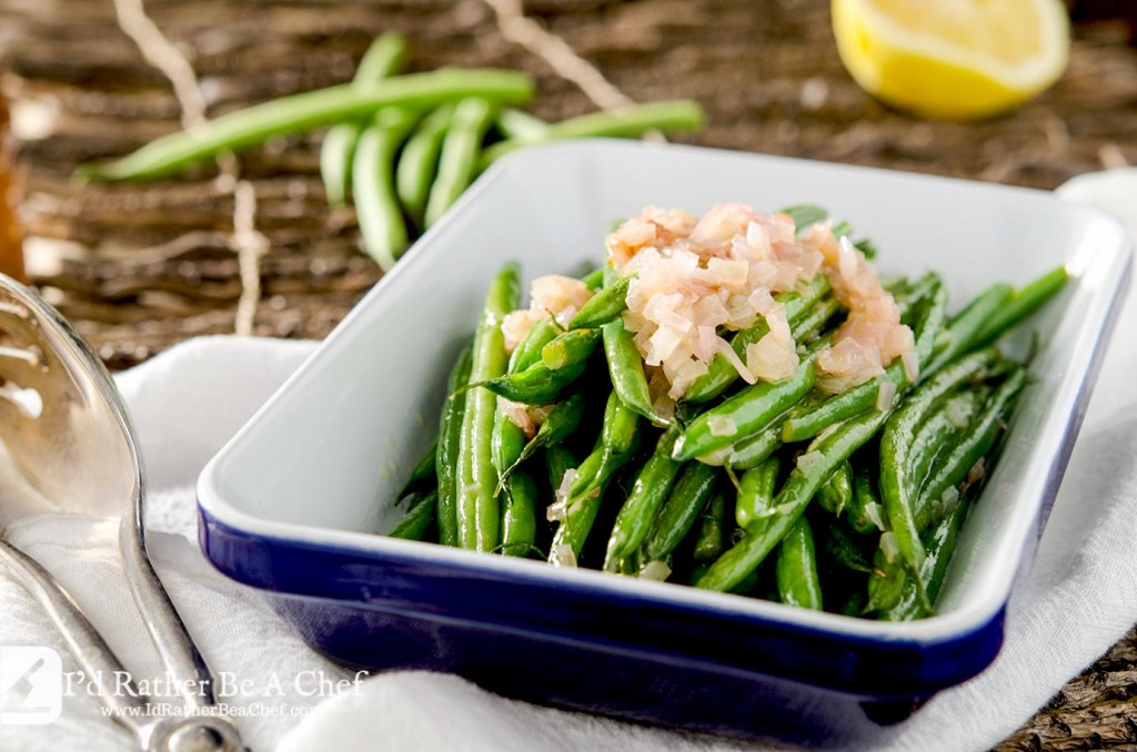 This easy haricot vert recipe builds incredible flavor with butter, shallots, lemon juice and a pinch of salt. Ready in under 10 minutes as a delicious vegetable side dish!
