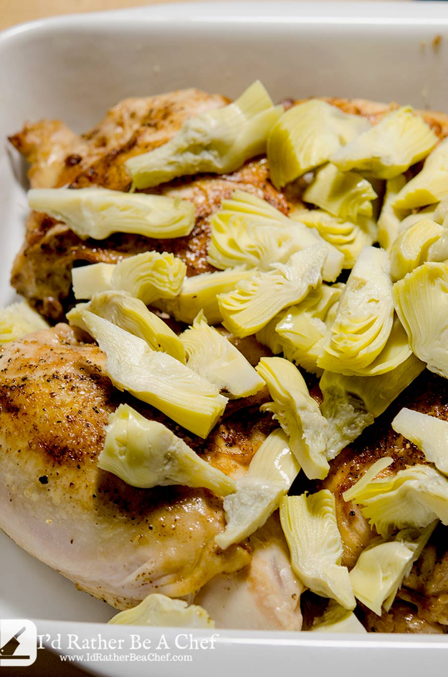 These beautiful quartered artichoke hearts add lightness and zip to this lemon artichoke chicken bake. They just taste so good with the creamy sauce.