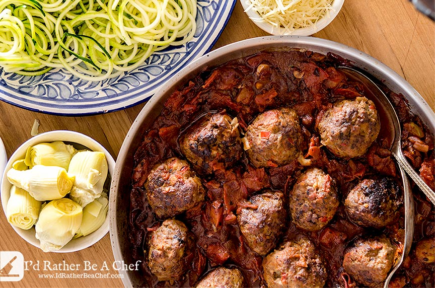 Low Carb Meatball Recipe with zoodles, parmesan, artichoke hearts and an easy marinara sauce. So delightfully yummy.