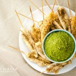 Oven baked chicken tenders with a pesto dipping sauce. Perfect for a party or an afternoon chillin and watching Netflix. This is a fast, easy baked chicken tenderloin recipe.