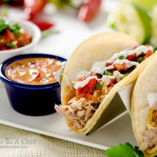 A perfectly delicious pulled pork taco recipe with pico de gallo salsa and a delicious chipotle pepper sauce! A Mexican fiesta!