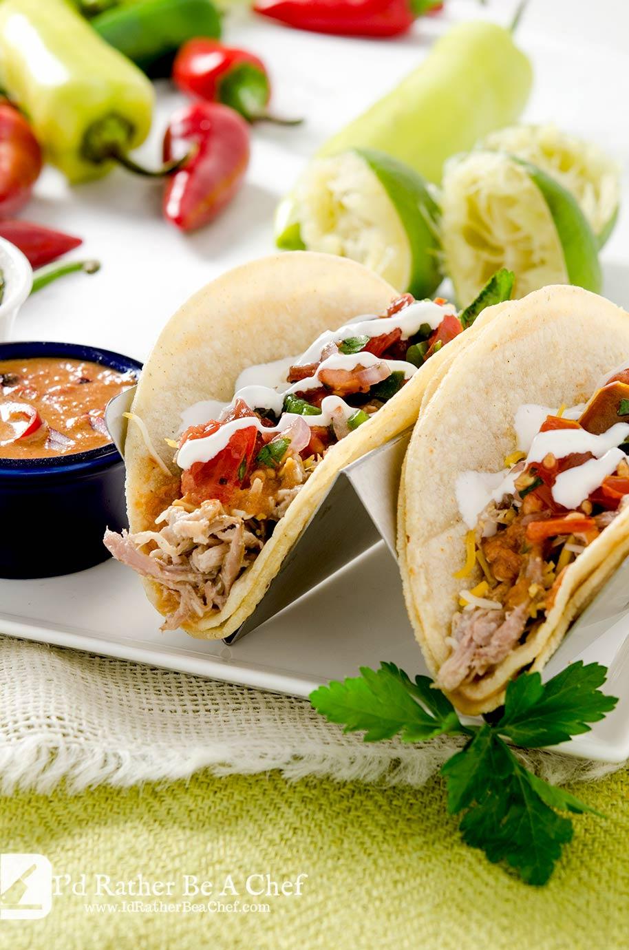 A super fresh pulled pork taco recipe with pico de gallo and a fresh chipotle pepper sauce. So delicious!