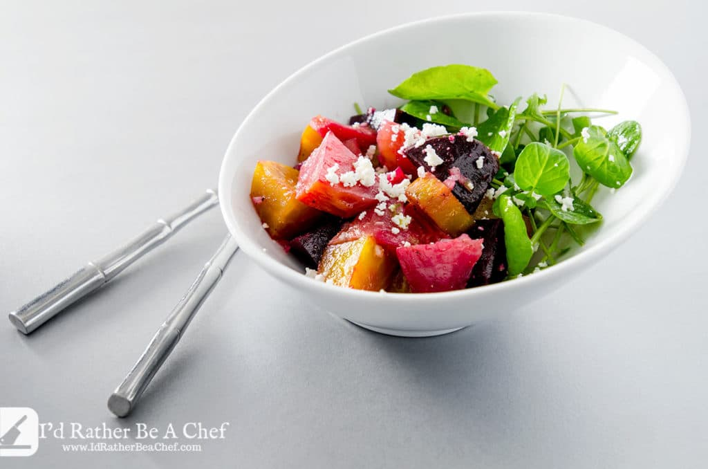 A perfectly balanced roasted beet salad with goat cheese, shallots, classic dijon vinaigrette and crisp watercress.