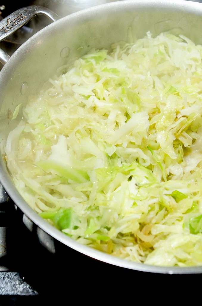 A sauteed cabbage recipe with bacon, apples, onion and garlic. The perfect cabbage side dish for any pork chop dinner.