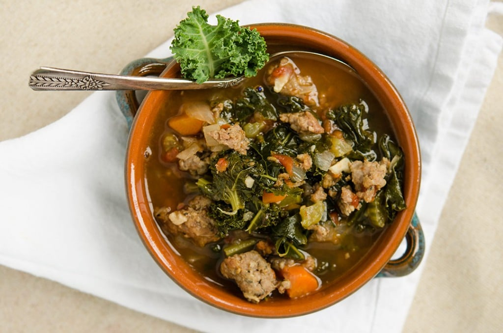 Tuscan kale soup is hearty and healthy at the same time. With loads of veggies, delicious spicy sausage and fresh kale, this recipe is a knockout!