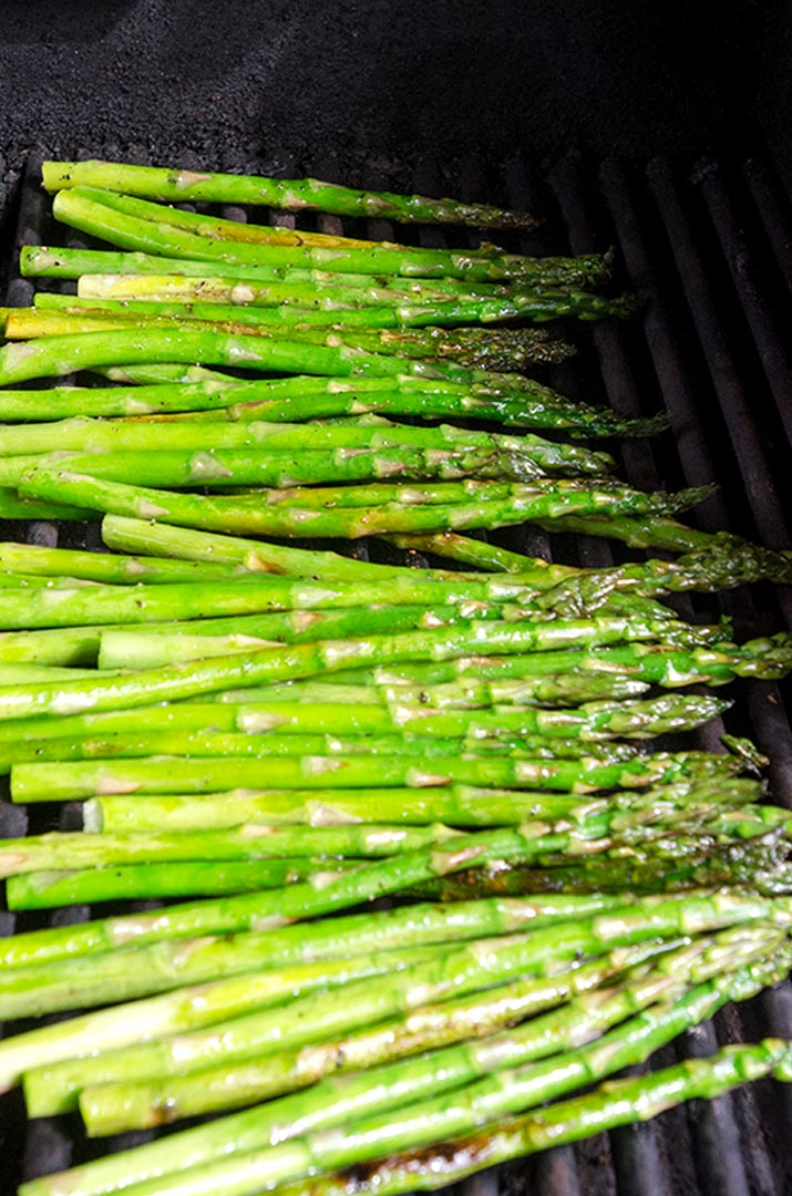 Grilled Asparagus Recipe Step 8: Place the asparagus on the grill and cook for 2 minutes. Flip and cook for 2 more.