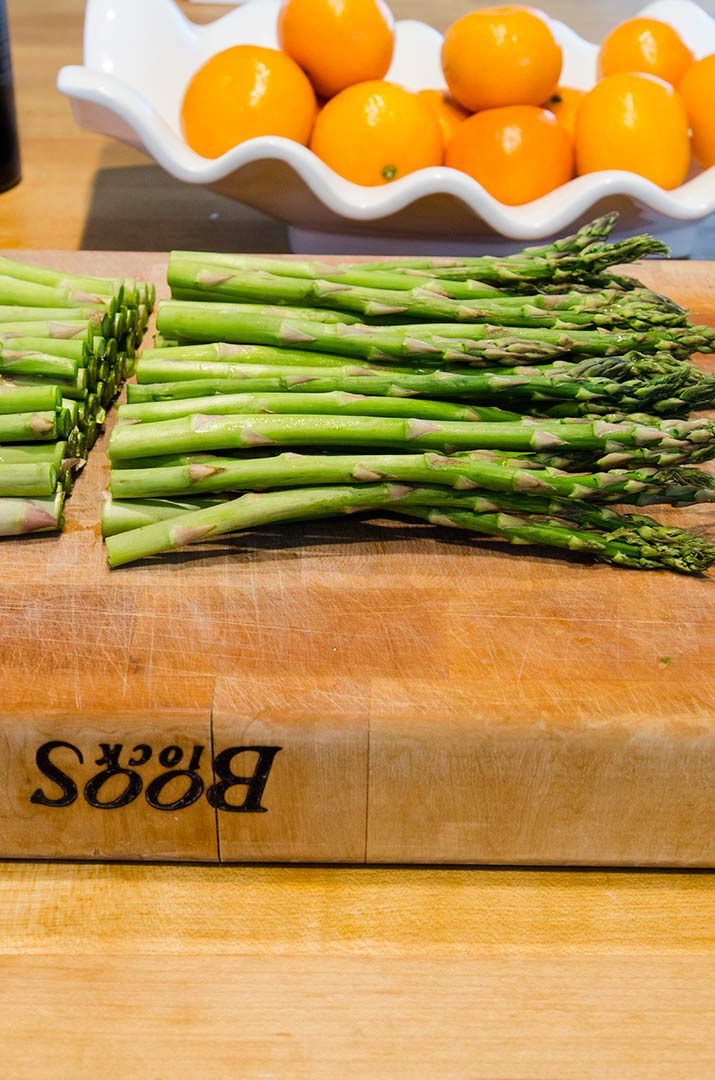 Grilled Asparagus Recipe Step 2: Find where the woody part of the asparagus is at and cut it off.
