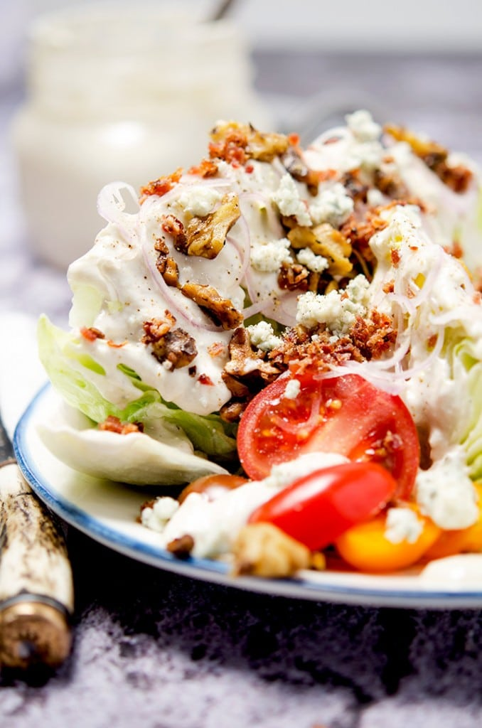 The ultimate iceberg wedge salad has all the toppings included: bacon, shallots, walnuts and more.
