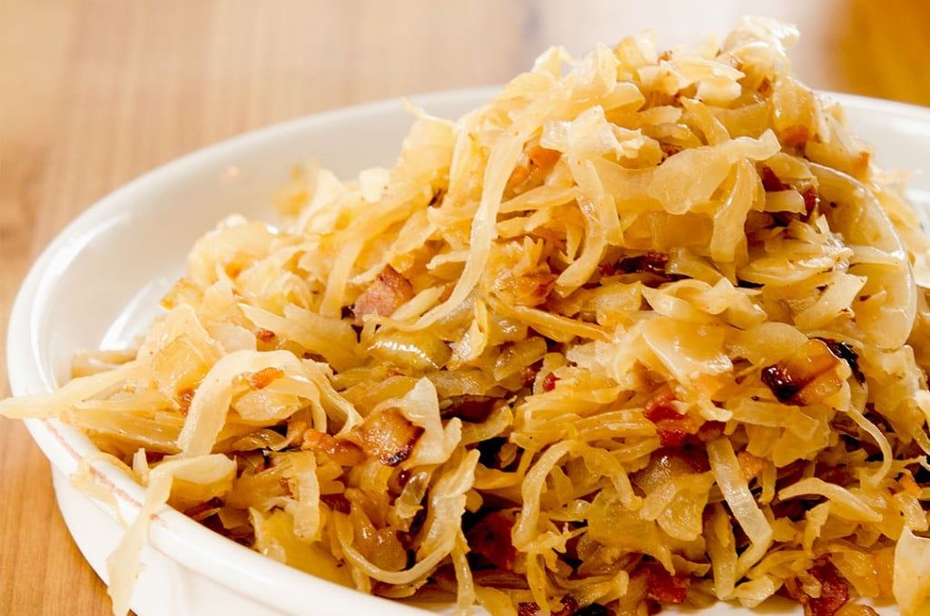 A super easy sauerkraut recipe, brought together with duck fat, bacon and onions. Semi-homemade too!