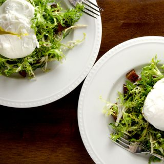 The perfect frisee salad, with bacon fat dressing, bacon croutons and a delightfully runny poached egg.
