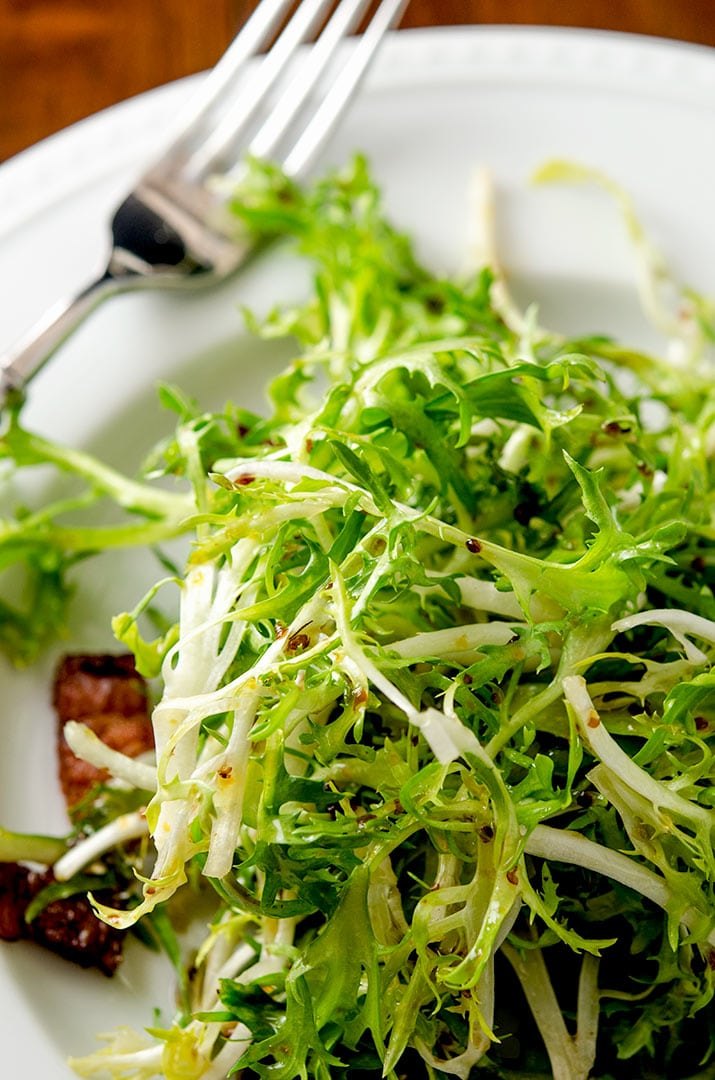 Oh yum. Frisee lettuce lightly dressed with the bacon fat dressing and crispy lardons. All it needs is the poached egg!