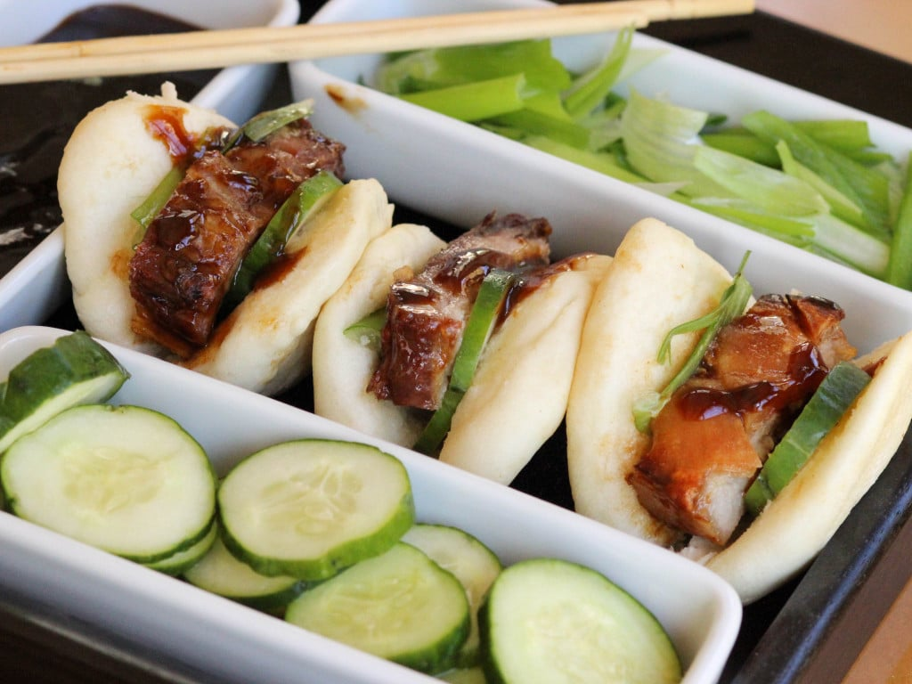 Pork belly on Chinese sticky buns is delicious. Enjoy it on our pork belly recipes roundup.