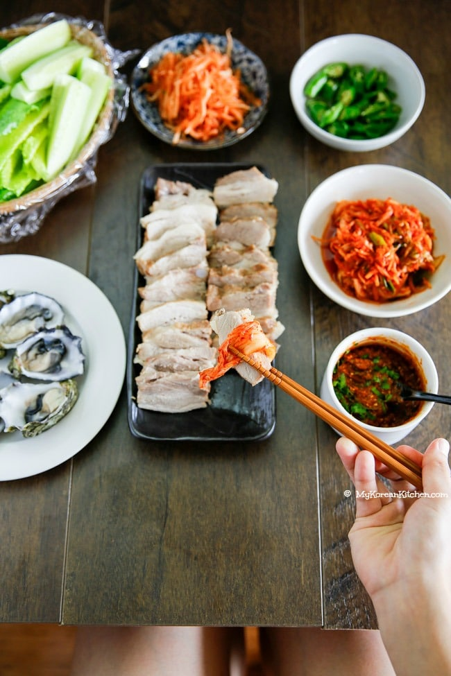We love Korean Pork Wraps infused with apple. The perfect addition to our pork belly recipes roundup.
