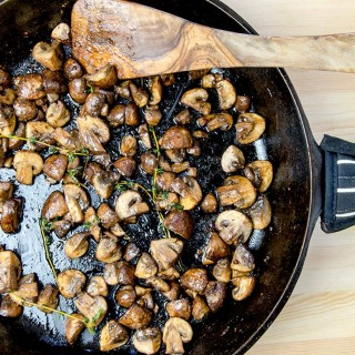A delightful sauteed mushrooms recipe cooked with roasted garlic and fresh thyme. Perfectly simple. Perfectly delicious.