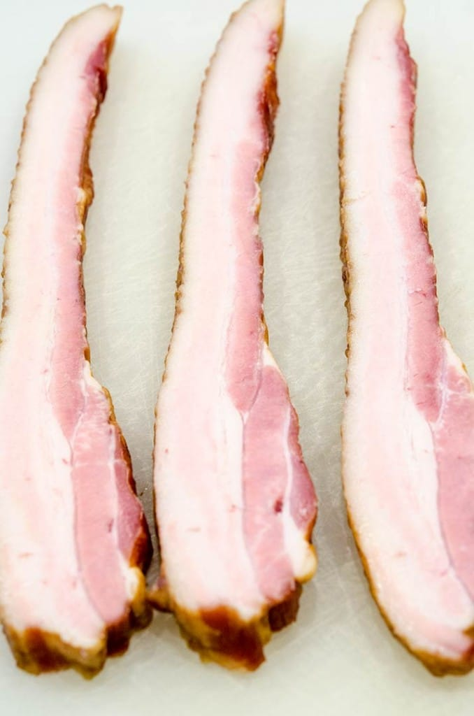 "When you buy slab bacon, cut it into strips that are just about 1/2"" wide. This will make delicious lardon."