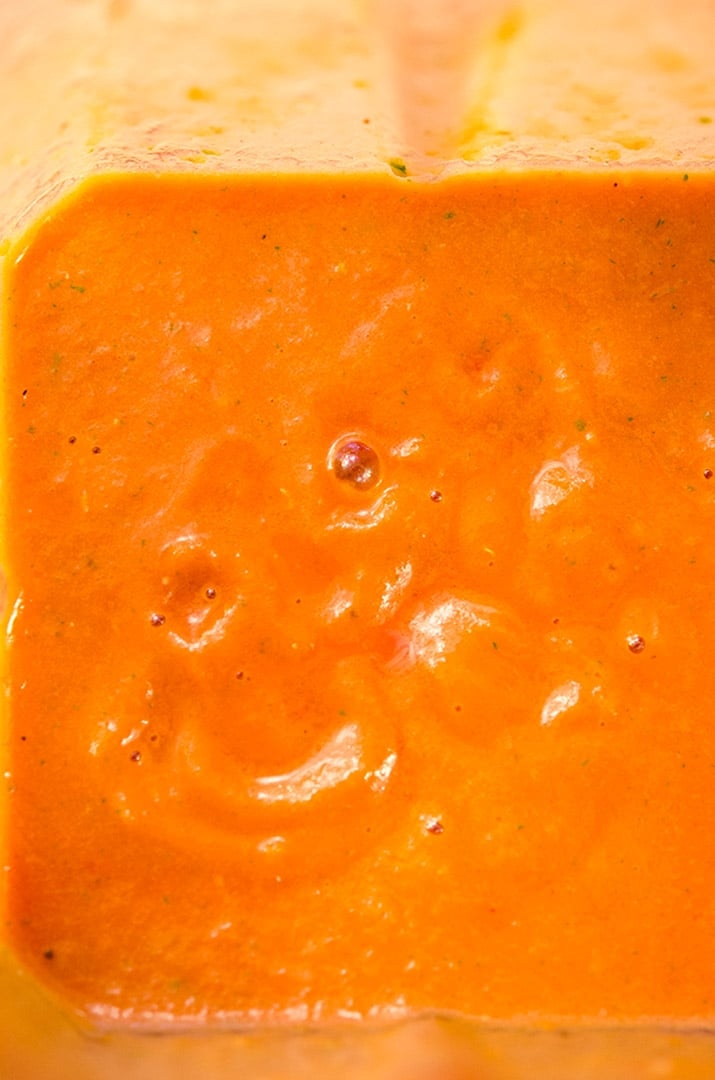 A simple tomato coulis recipe that is made in the blender. It turns a salmon color after blending.