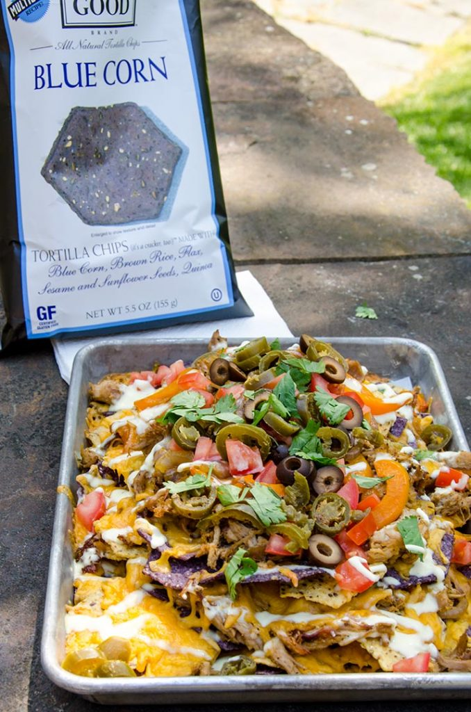 I like to eat my fajita nachos outside when the weather is nice. Just dig right in... All you need are a couple napkins and the desire to get a little messy.
