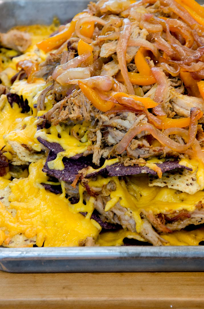 Fajita Nachos Step 3: Add another layer of chips, more cheese and the remaining pork, peppers and onions. Back in the oven one last time!
