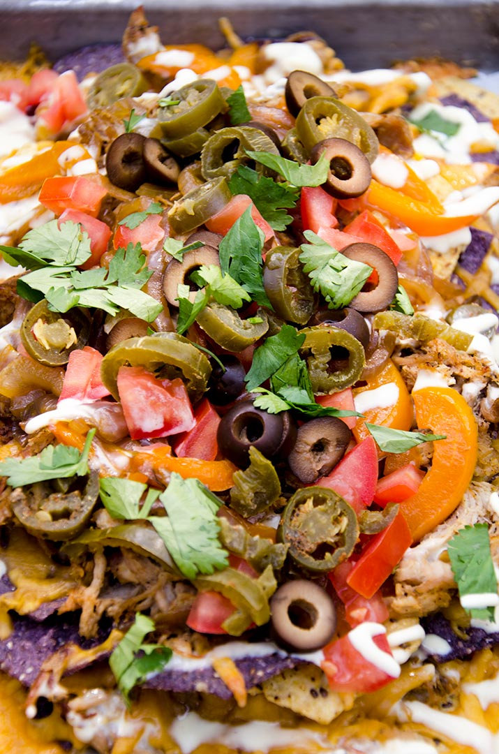 I just want to eat these fajita nachos right now. The crispy pulled pork and fresh ingredients made these literally sing in my mouth! Awesome.