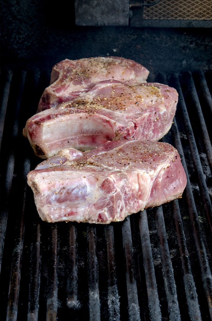 Grilling pork chops is easy when you change the heat on the grill and achieve perfect steakhouse marks on the pork chop