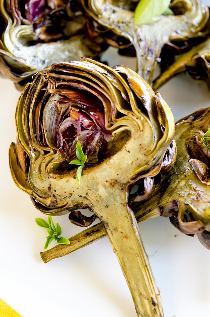 The end result of all the cleaning, steaming and grilling is a tender, juicy and delicious grilled artichoke. So damn good. I hope you enjoy.