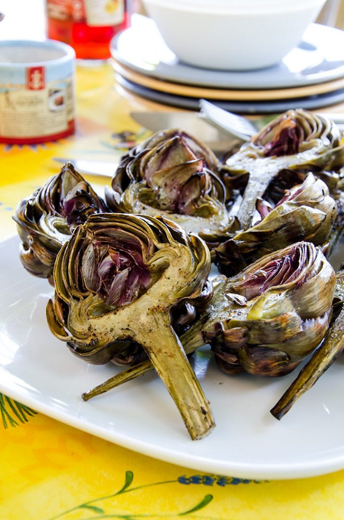 At our table a plate of grilled artichokes means a happy family. Everyone loves these.