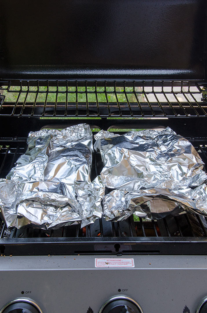 To make grilled artichokes, we are going to steam them in a foil pouch right on the grill. The result is a tender and delicious artichoke with minimal cleanup!