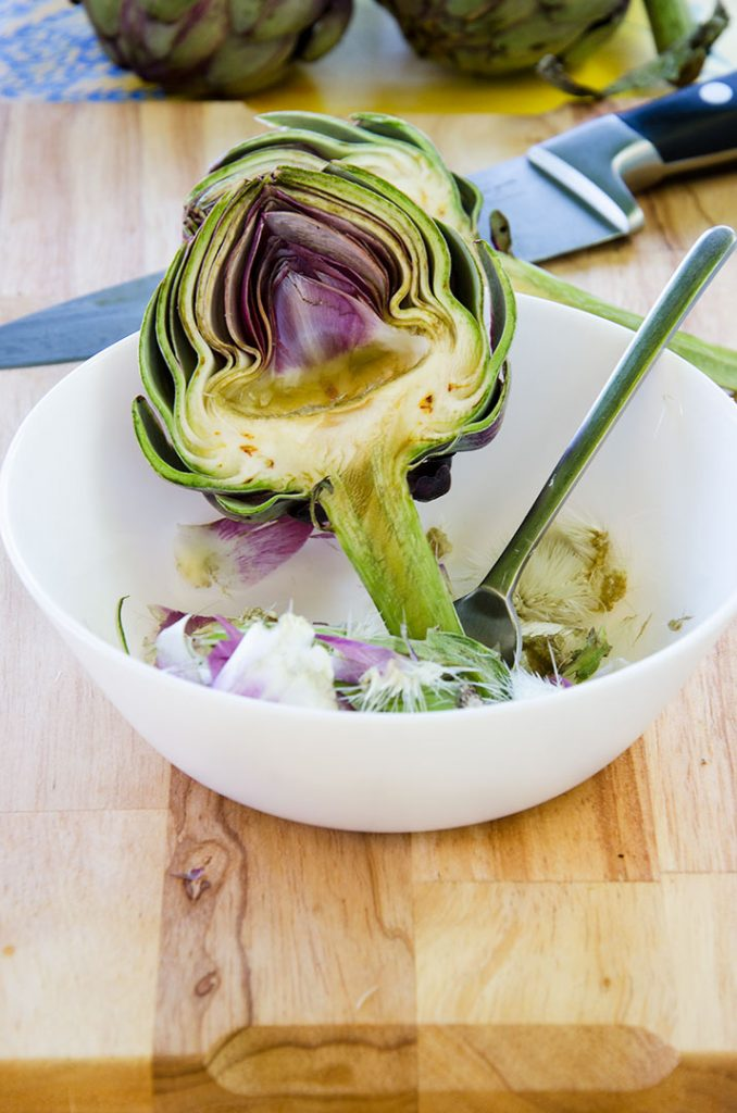 To make grilled artichokes the fuzzy choke needs to be removed with a small spoon before grilling.