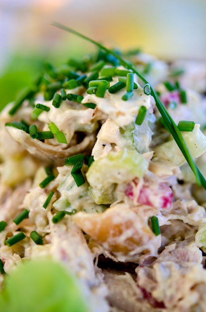 A rotisserie chicken salad needs time to cool in the refrigerator before serving to your guests. It is best served cold, either in a lettuce wrap or piled high between two halves of a fresh croissant.