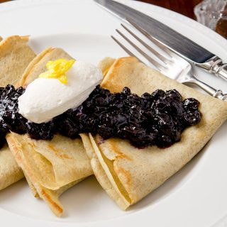 A delicious gluten free crepe topped with blueberry compote and vanilla maple whipped cream. A true breakfast delight.