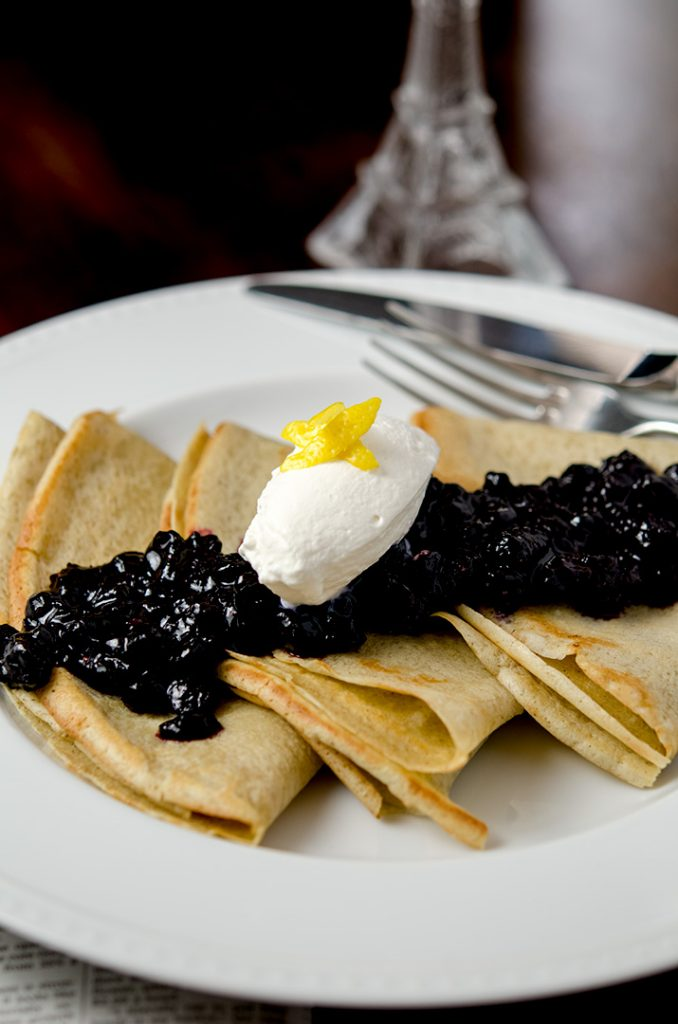 Topping gluten free crepes with blueberry compote takes them from ordinary to extraordinary! Just a delicious breakfast or brunch.