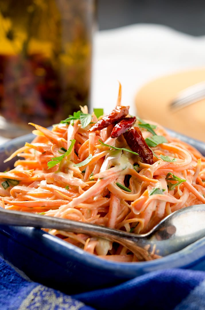 This spicy carrot salad recipe pairs perfectly with BBQ or grilled meats. The balance between the cooling sauce and the spicy oil make it just divine!