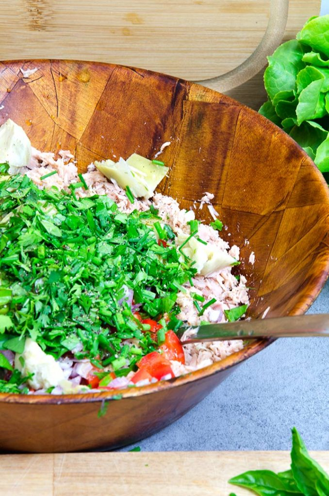 Add the herbs to the tuna salad after all the other ingredients have been added. Mix slowly and taste. If it is dry, add more oil.