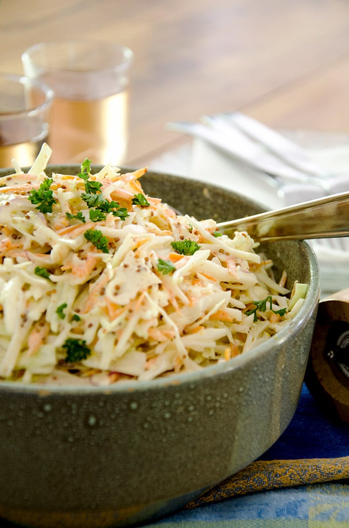 This coleslaw recipe is made with love... and a little mustard. They both add the perfect spice to life!