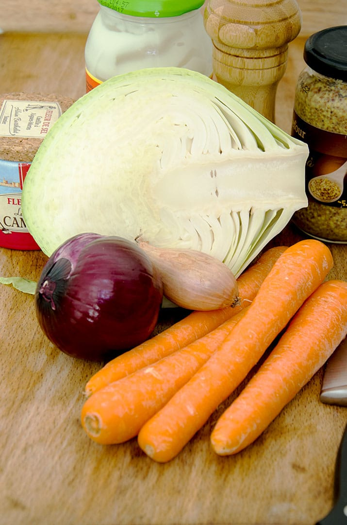 To make this coleslaw recipe you need cabbage, carrots, red onion and a few other pantry ingredients.