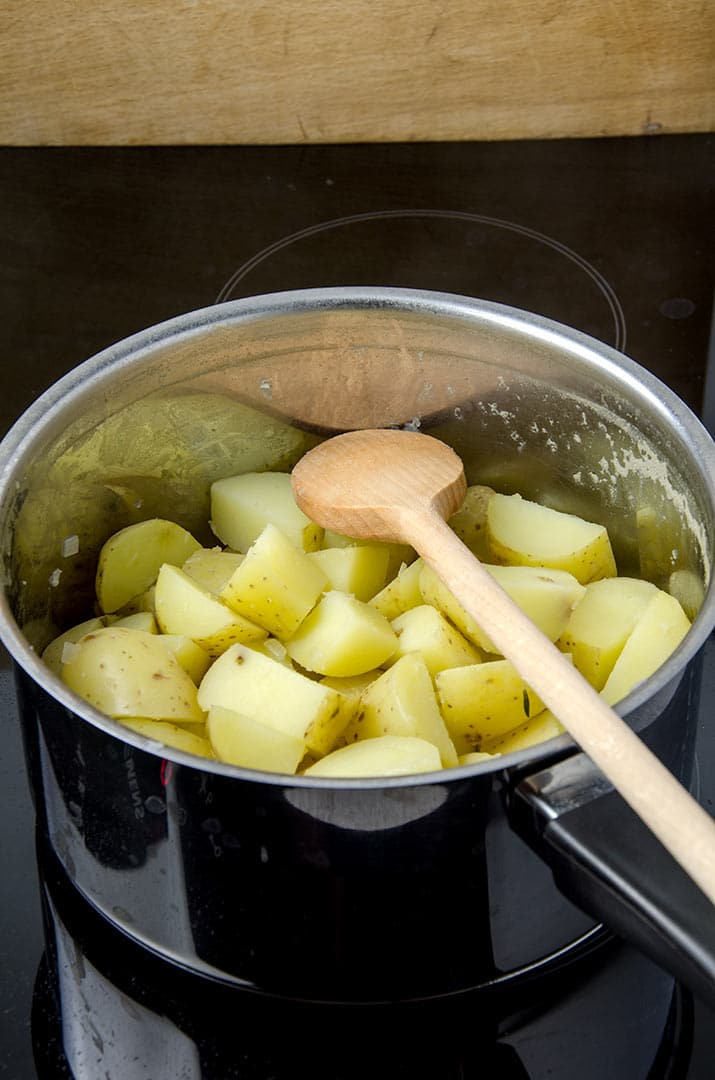 Smashed potatoes are best when all the liquid is cooked off.