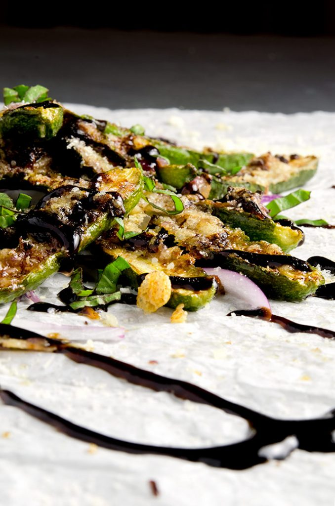 Zucchini fries are best with parmesan, balsamic glaze and a bit of fresh basil. Super fresh and delicious.