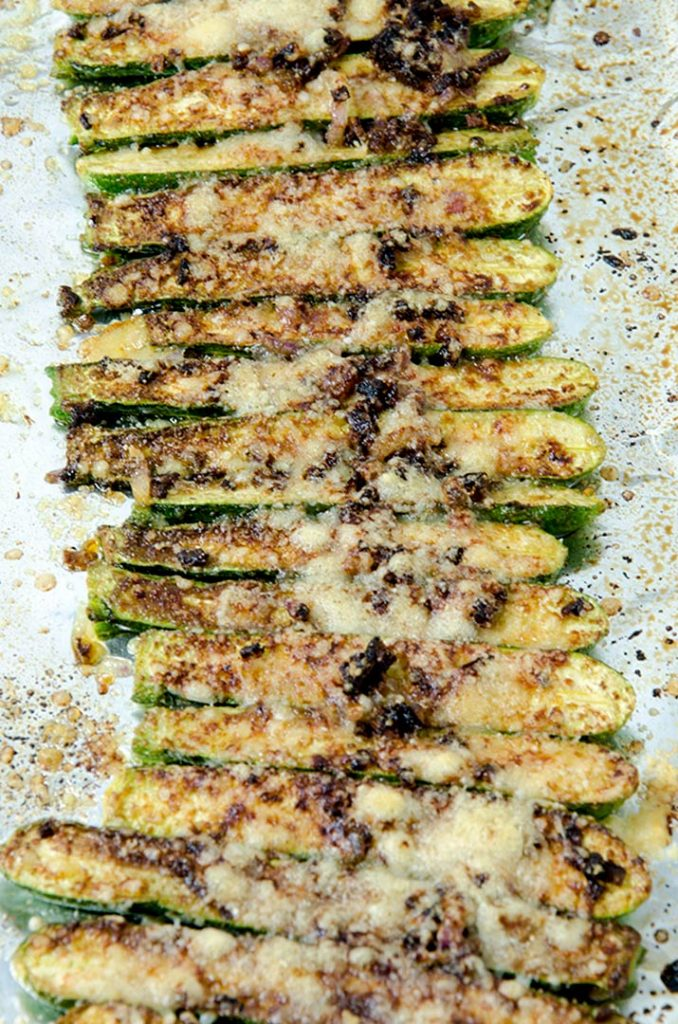 Baked zucchini fries are delicious with sauteed onions, balsamic vinegar and freshly grated parmesan.