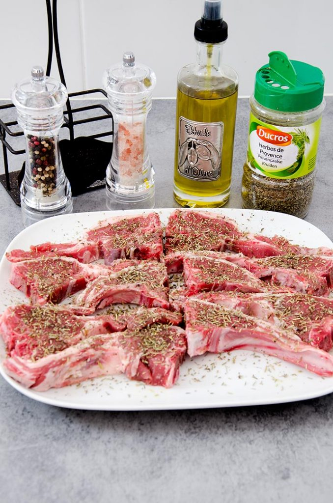 When grilling lamb chops, it is imperative to properly season the chops before they go on the grill. Simple seasoning is the best!