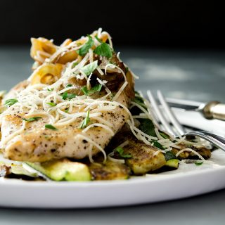 A fantastic sauteed chicken breast that is juicy, tender and delicious. Smother it with onions, shallots, garlic and place it atop a bed of sauteed zucchini... perfection on a plate.