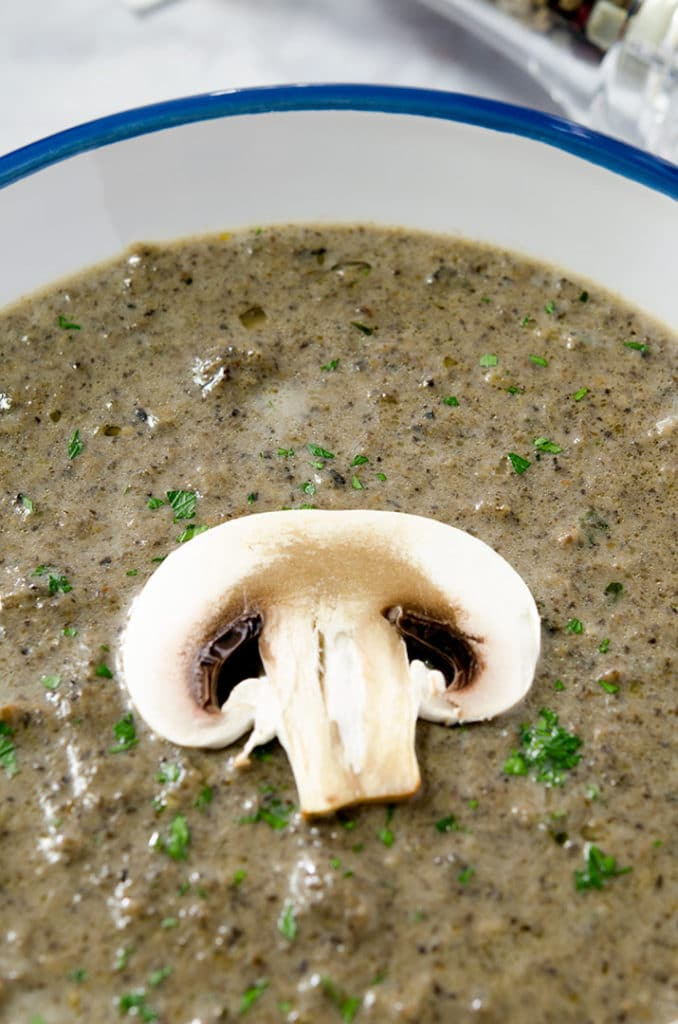 Topping a good cream of mushroom soup with a thinly sliced mushroom is delicious. Or add on sour cream or creme fraiche.