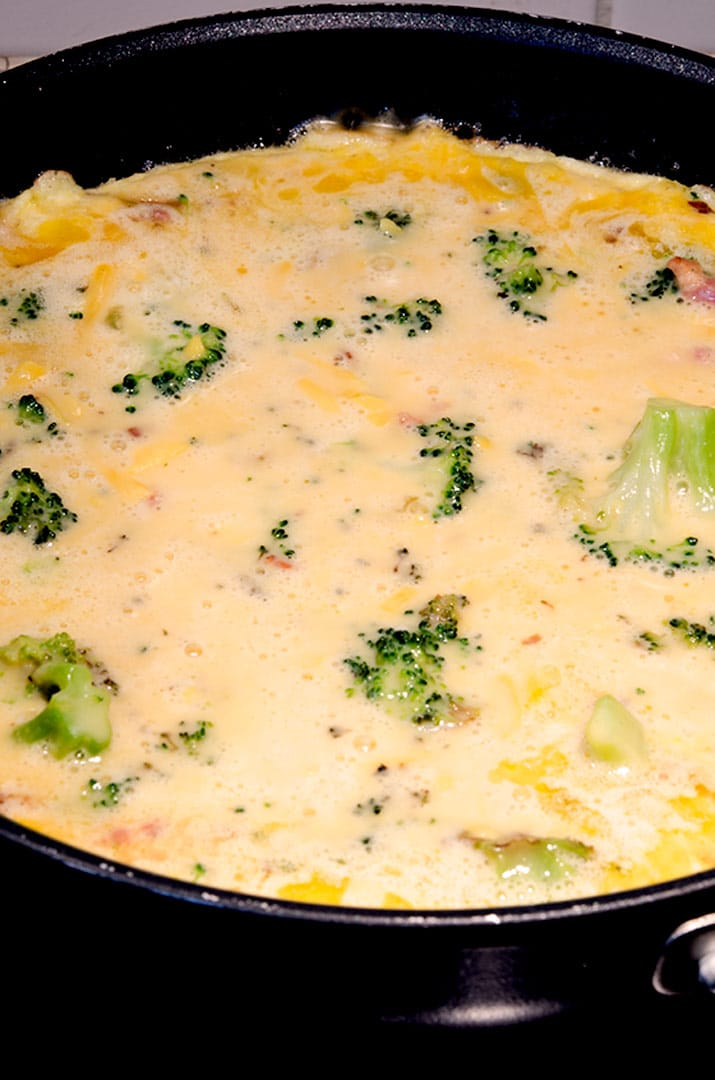 To get a nice crust on an egg frittata, coat the pan with butter, add the egg mixture and cook over high heat until the butter bubbles around the edges. Then add to the oven.
